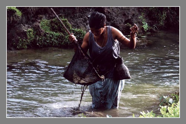 TRADITIONAL FISHING BY A RAVA GIRL PHOTOGRAPH BY BISWAJIT RAY FROM WEST BENGAL